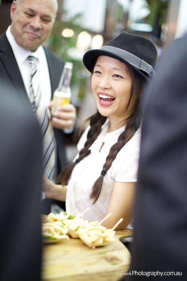 Asian waitress serving at Melbourne Cup