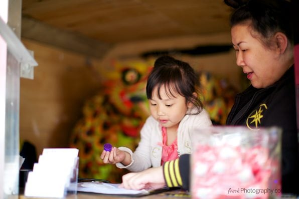 Asian girl stamping manningham festival passport