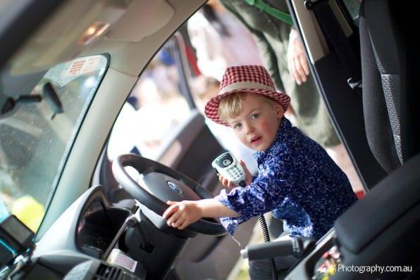 Kid in police car - Melbourne