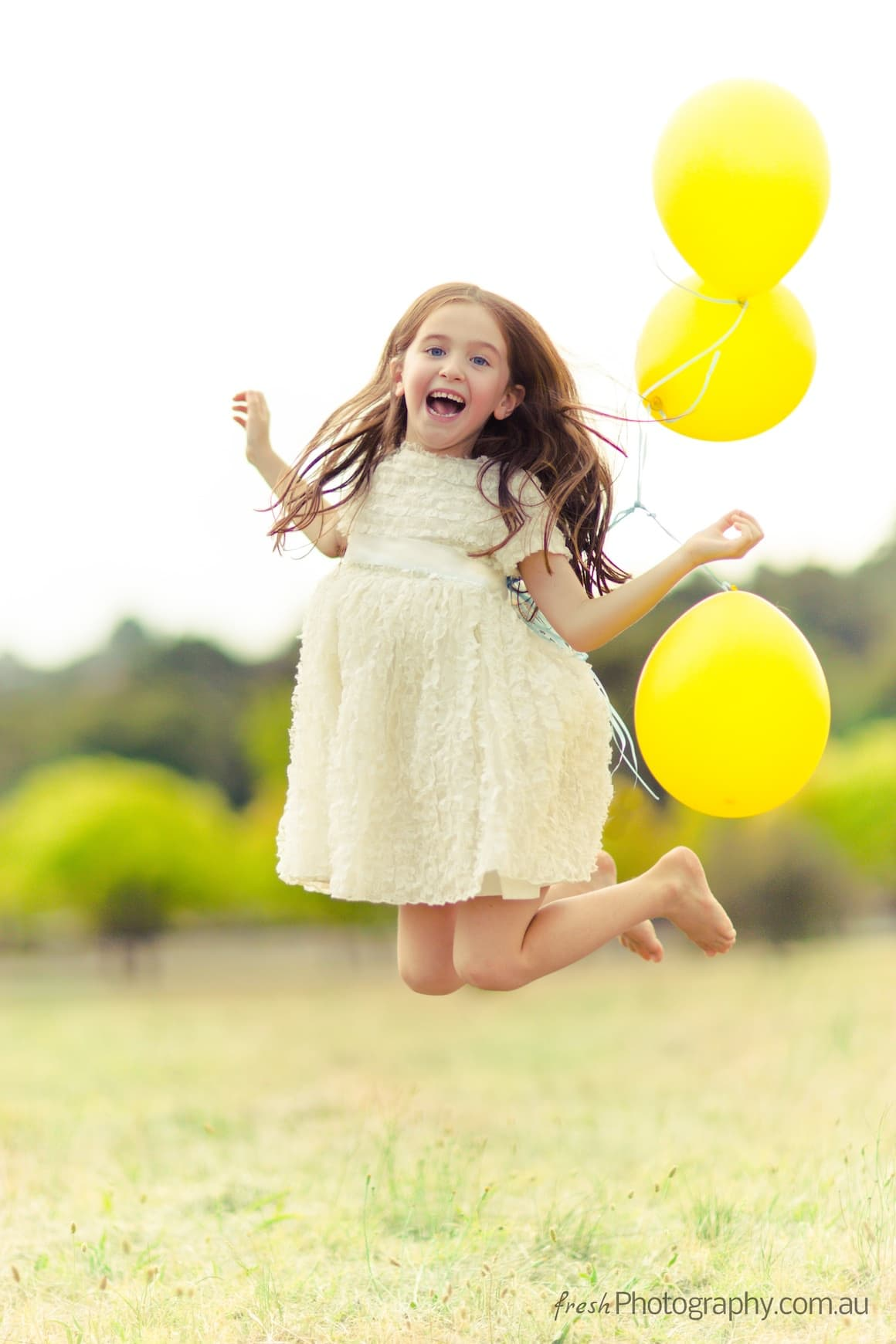 cute girl jumping with balloons - Happiness