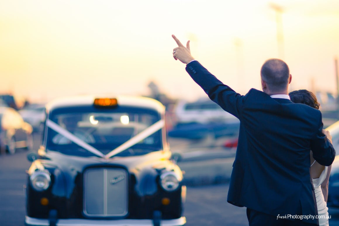 Photography at one of Melbourne's piers near Brighton ... Groom hailing a London Taxi