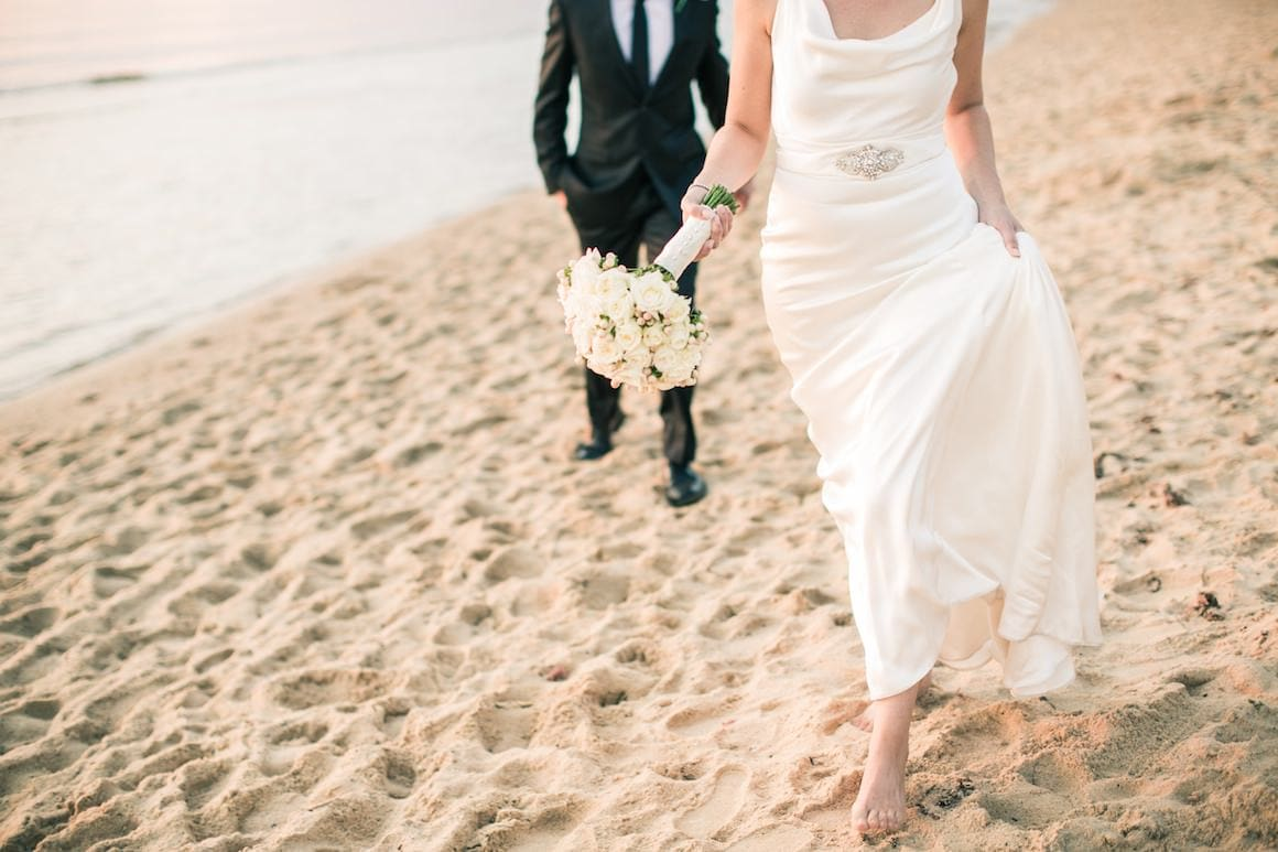 Walking along the beach - wedding photography in Melbourne