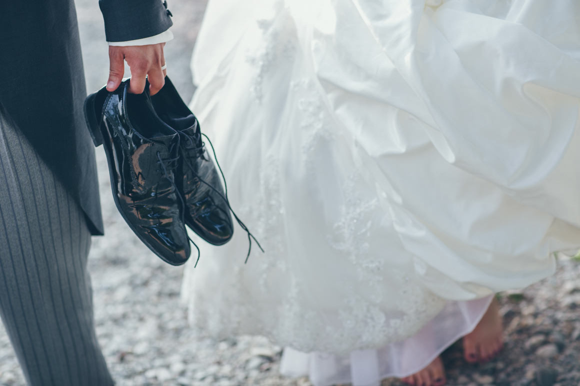 groom carrying the shoes - wet feet
