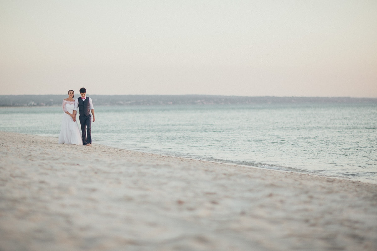 beach walk at sunset - pretty bride and handsome groom celebrating - best beach photography at melbourne weddings