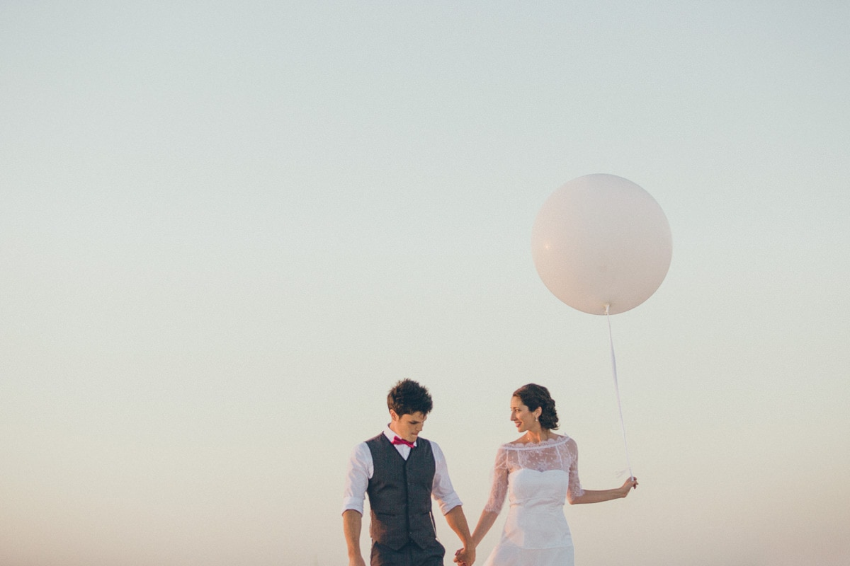 oversized balloon wedding prop in melbourne photoshoot at beach - natural wedding photography melbourne