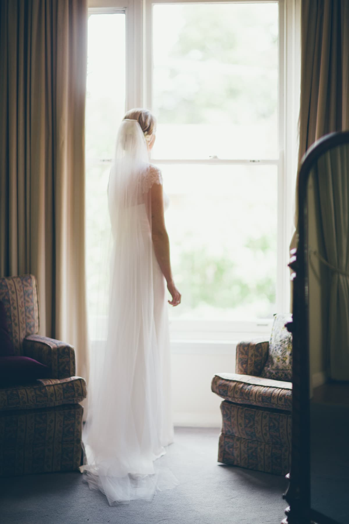 bride looking outside - window light - elwood wedding photographer
