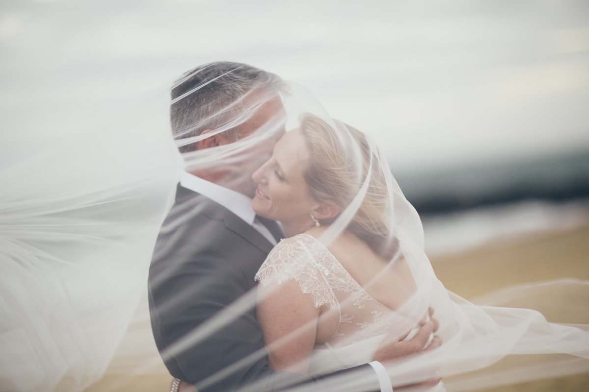 couple under the veil - kissing