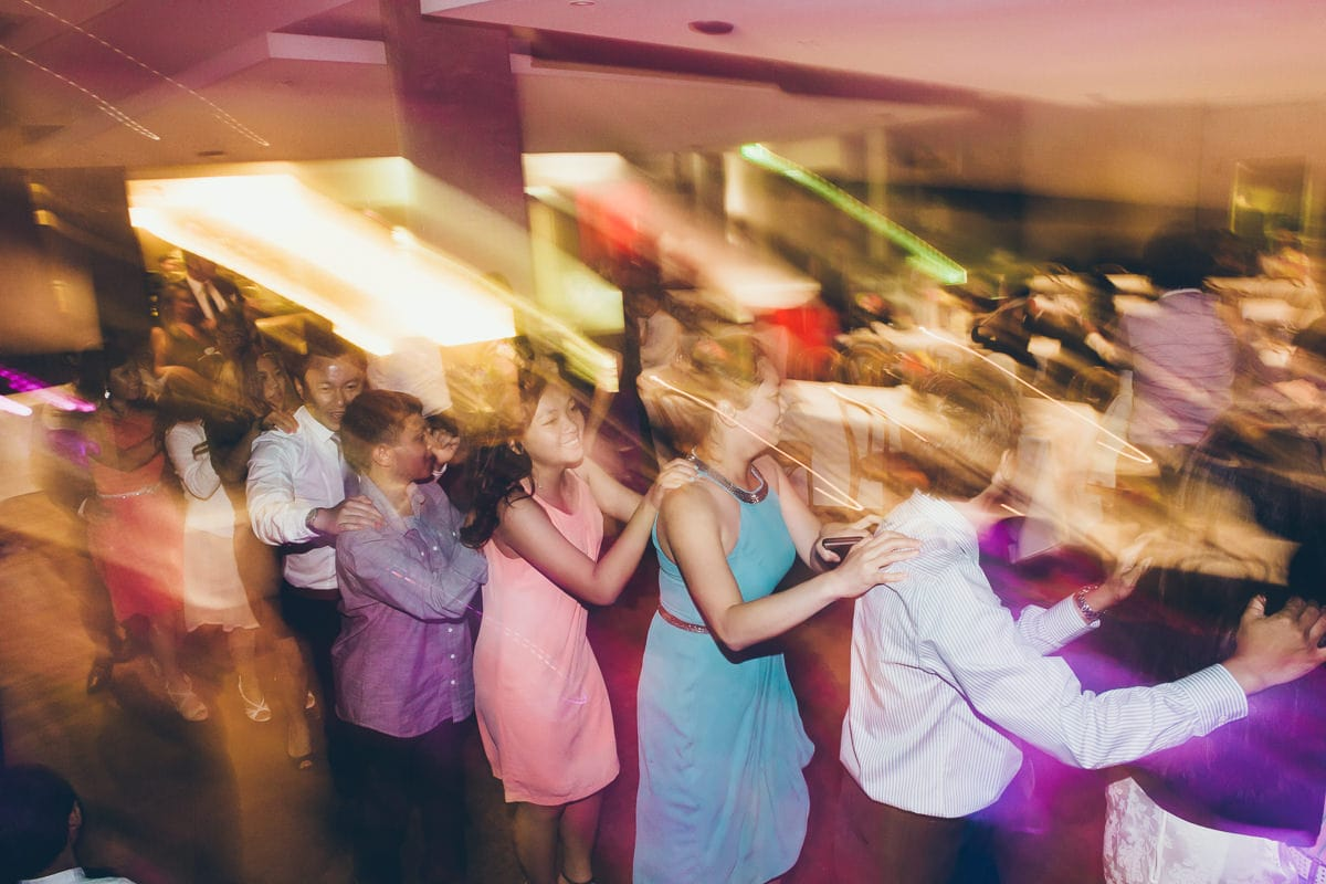 asian dancing at wedding party - creative melbourne photography