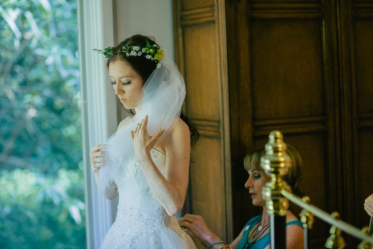 bride getting ready in her room - beautiful wedding gown