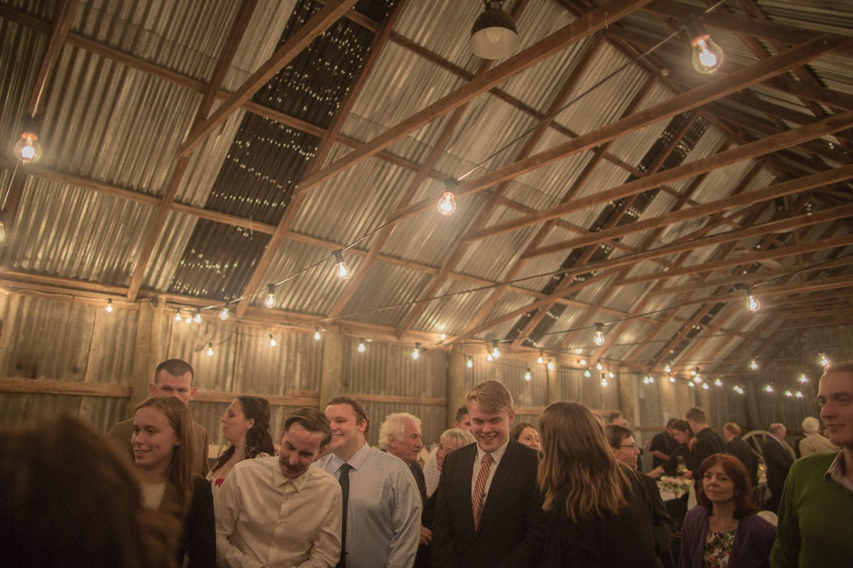 the barn lit up with fairy lights