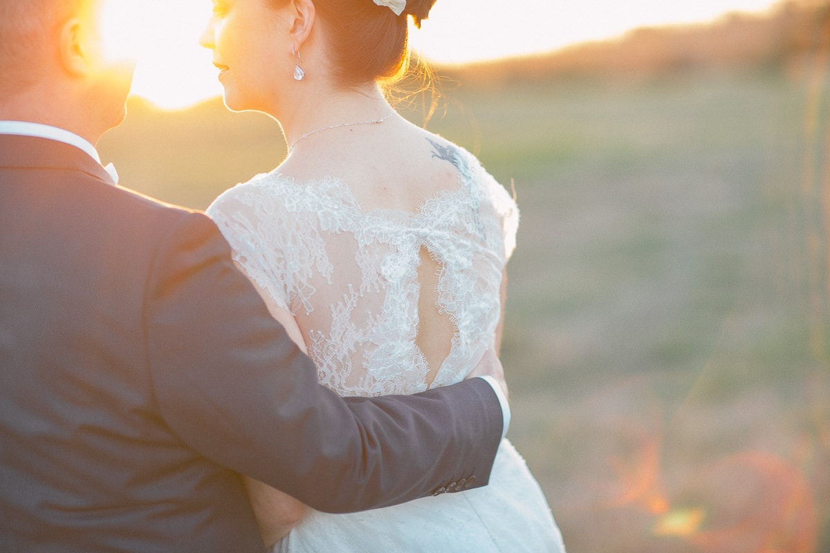 love - vintage farm wedding with celebration in the barn - photographer captures beautiful sunset