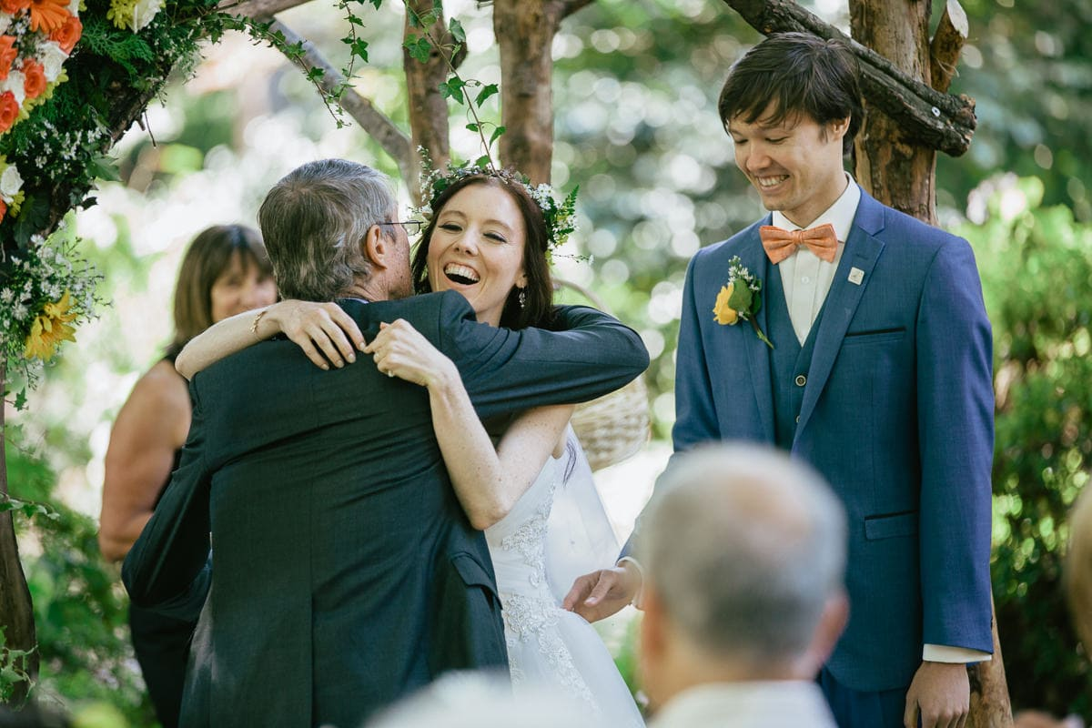 joy and emotion at wedding ceremony in the george tindale gardens