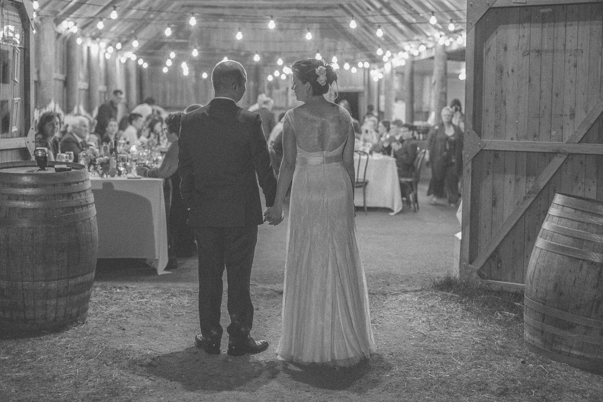 couple standing looking in barn