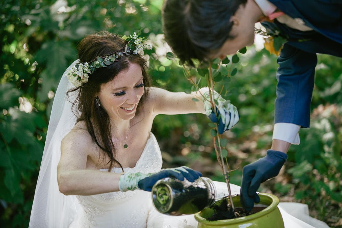 planting a tree as wedding ritual - outdoor ceriemony in the forest