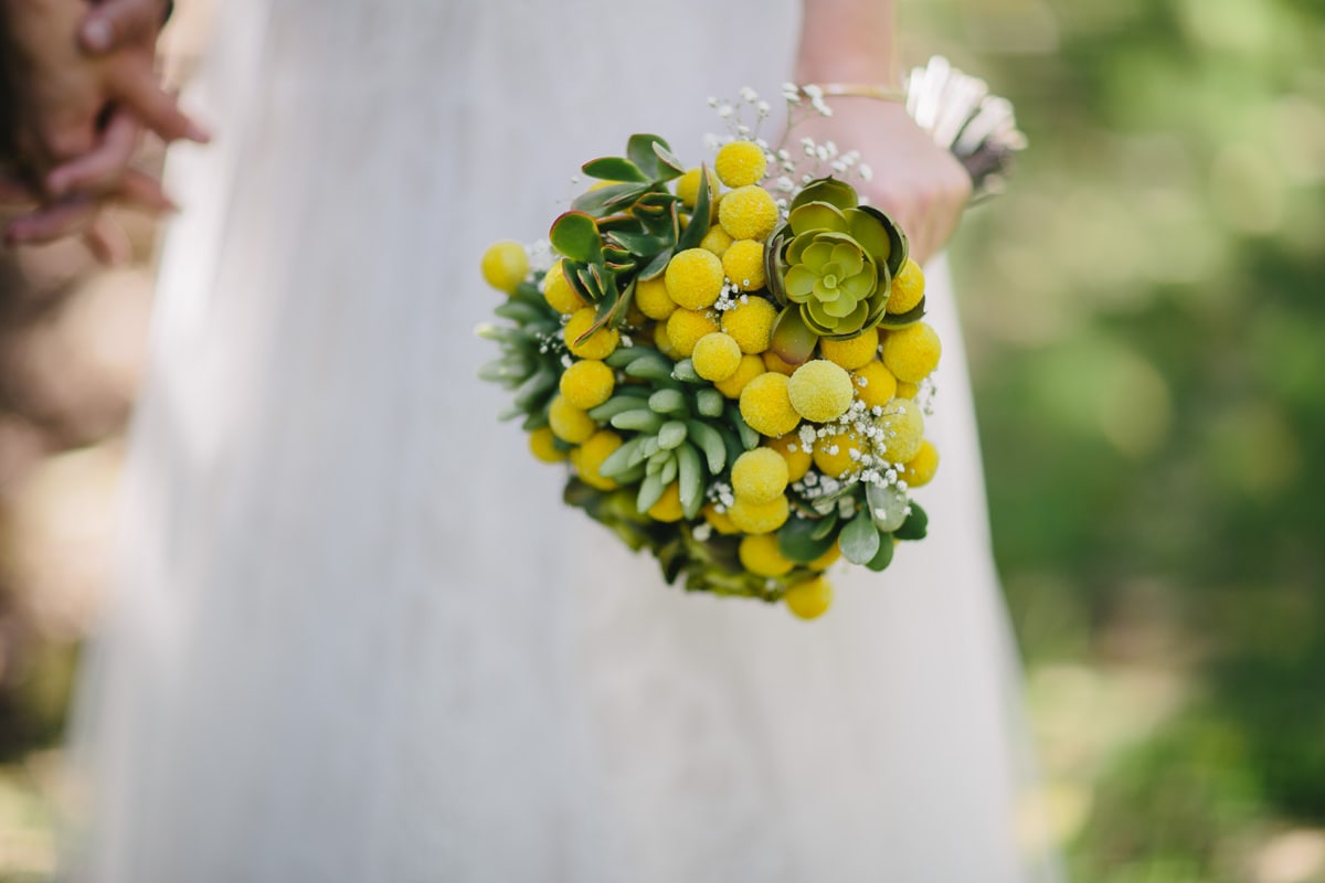 bride carrying yellow bouquet