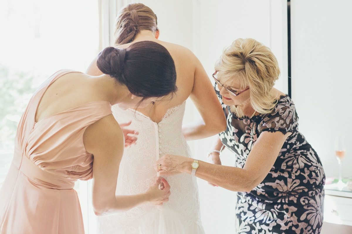 bride getting dressed - wedding photographer st kilda