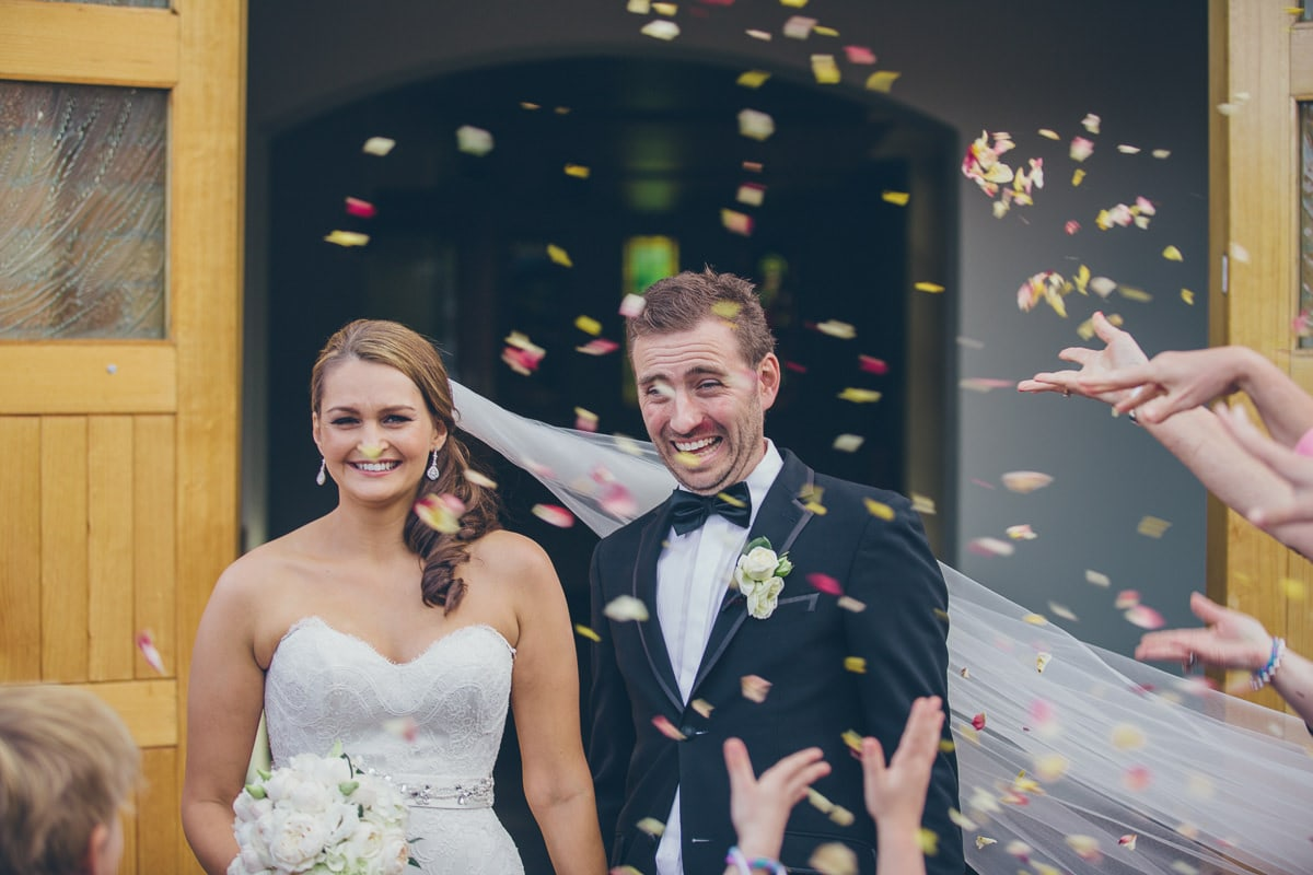 confetti at wedding after the church - married couple - best wedding photography melbourne - st kilda beach wedding