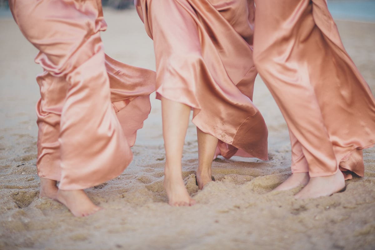 bridesmaids barefoot on the beach