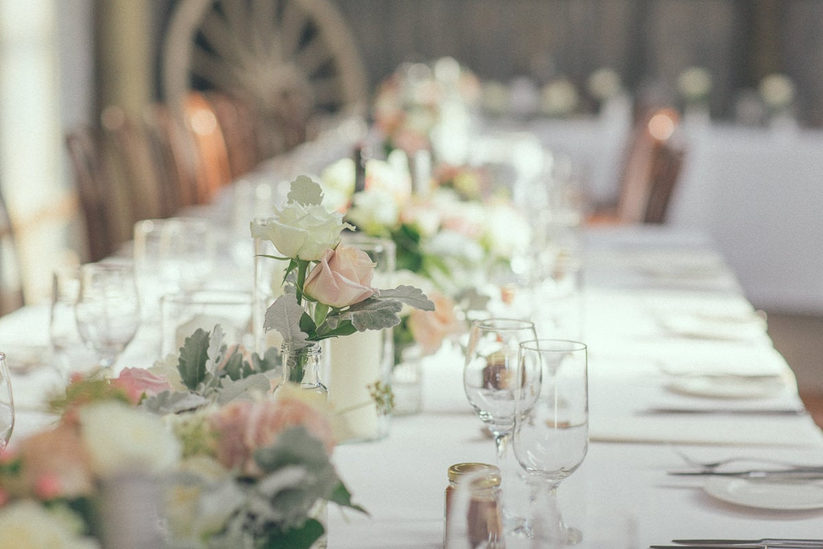 stunning table setting in rustic barn