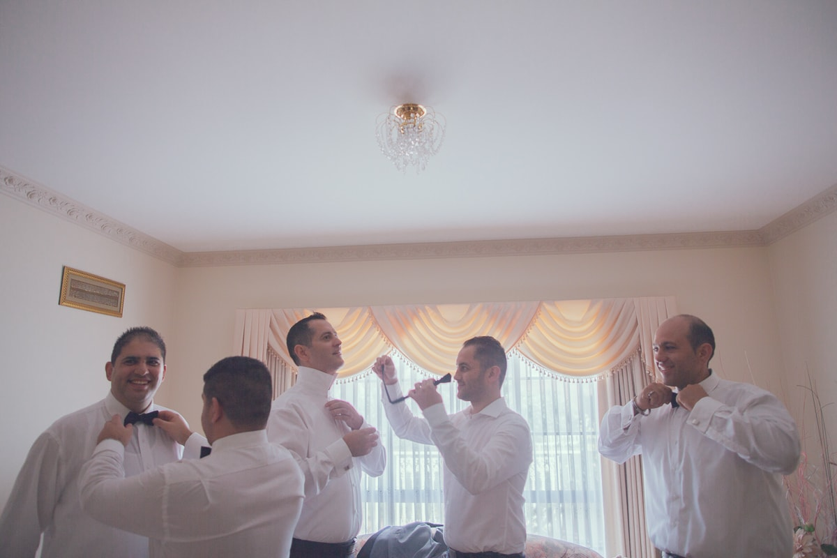 groomsmen backlit at grooms house - turkish wedding photographer