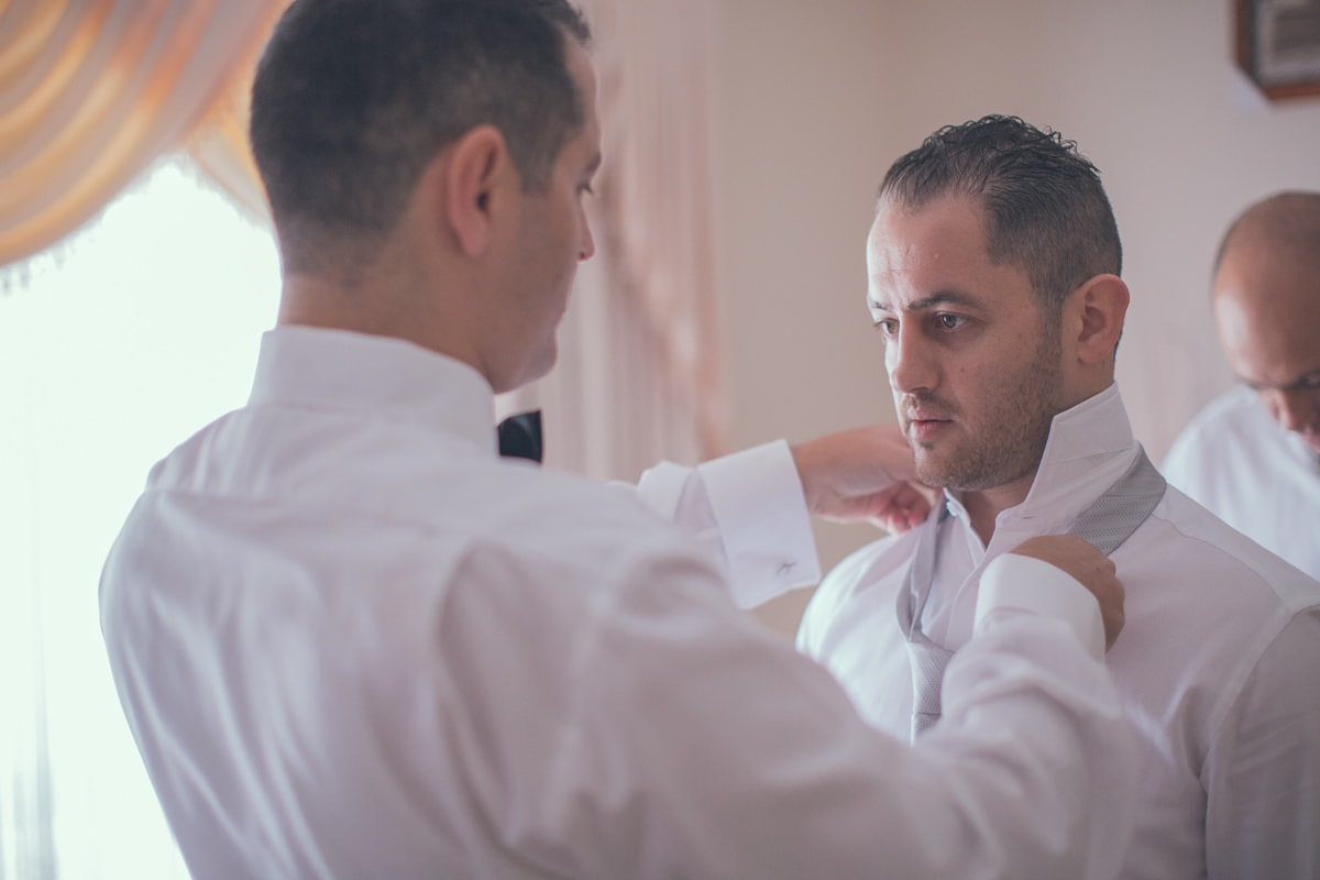 groom fixing up tie