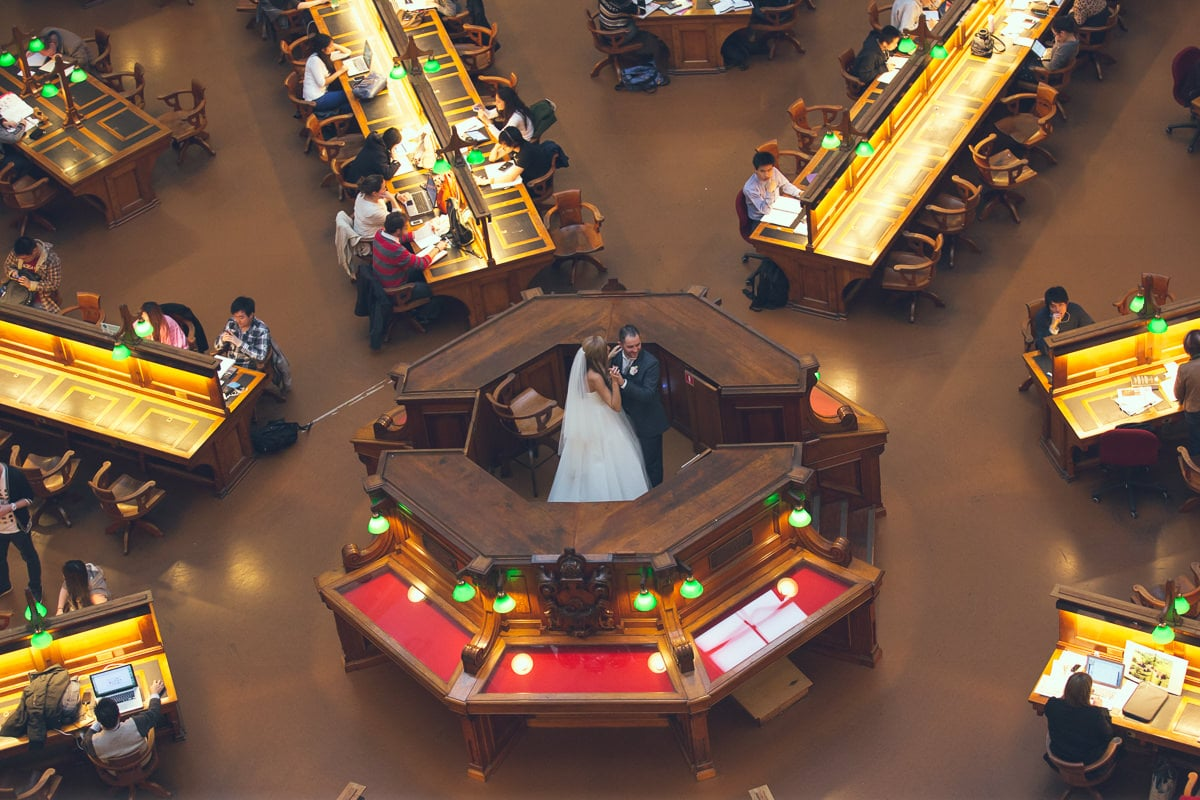 wedding couple in the middle of the reading room at the sate library in melbourne
