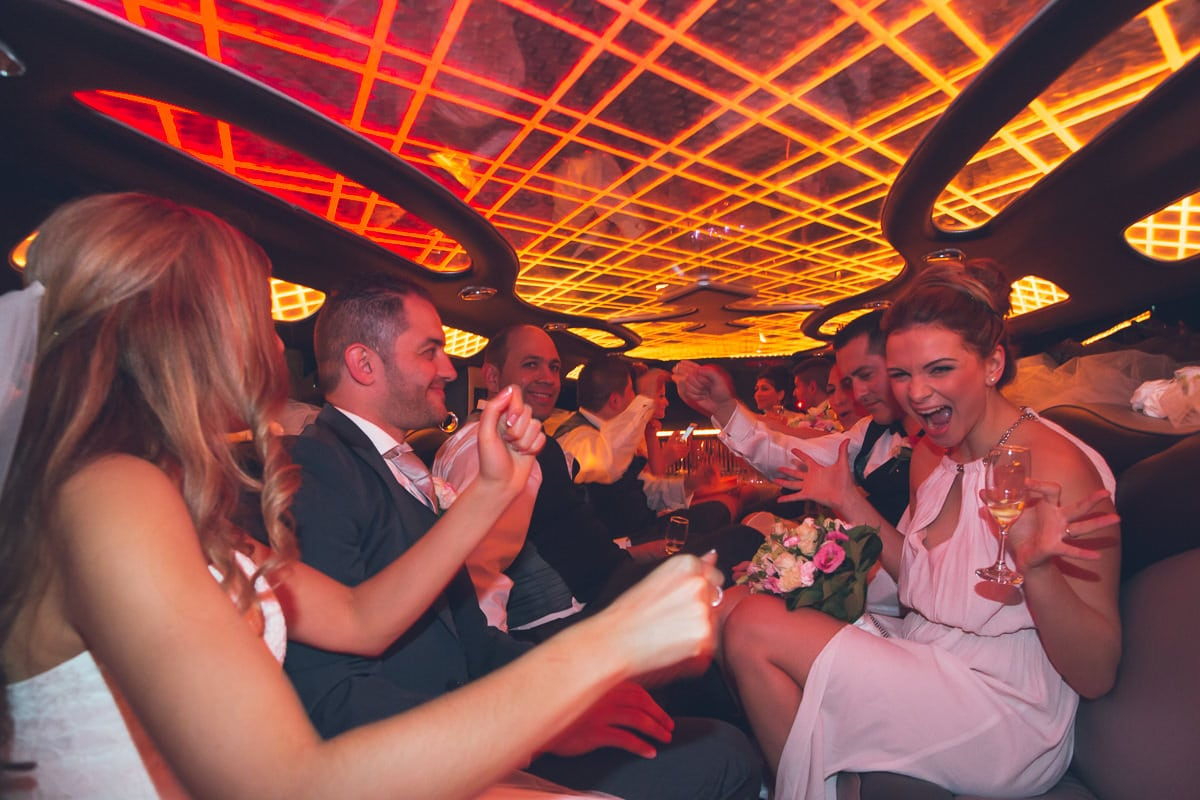 in the limousine - driving to wedding function captured by melbourne photographer
