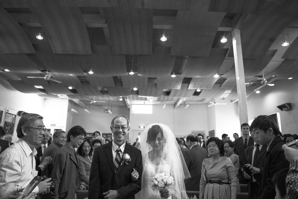 father walks down bride the aisle