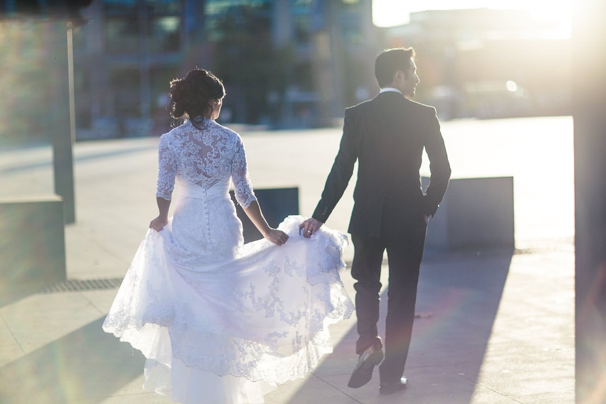 bride and groom walking away - backlit photos
