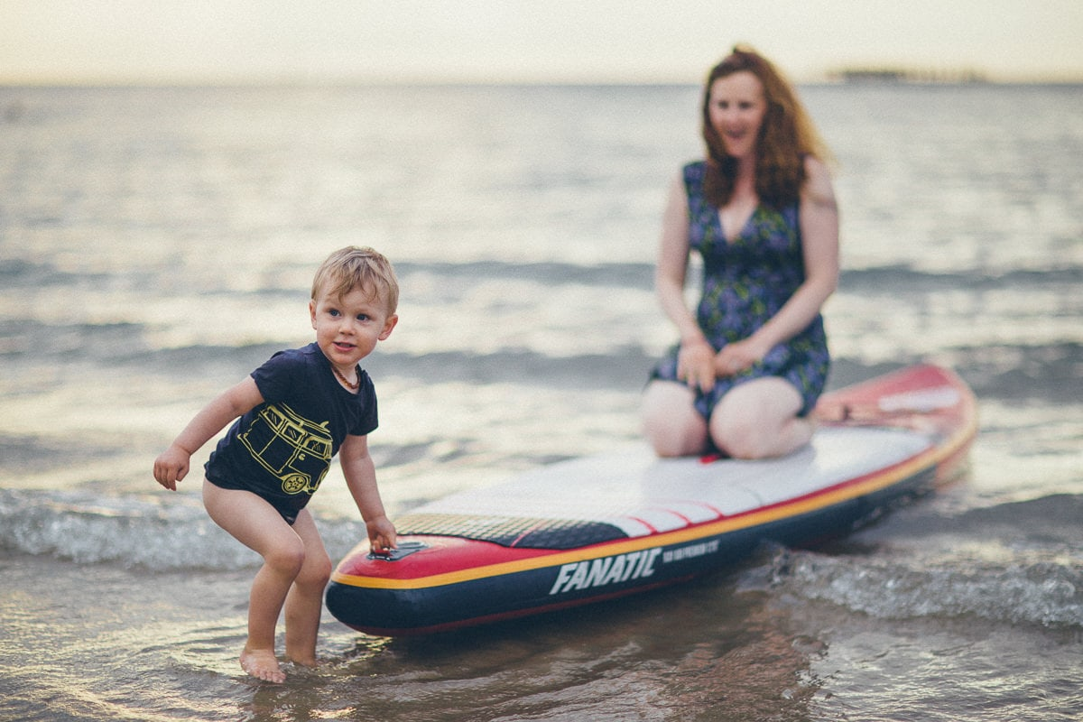 kid holding sup - Stand Up Paddle - Natural beach family photos