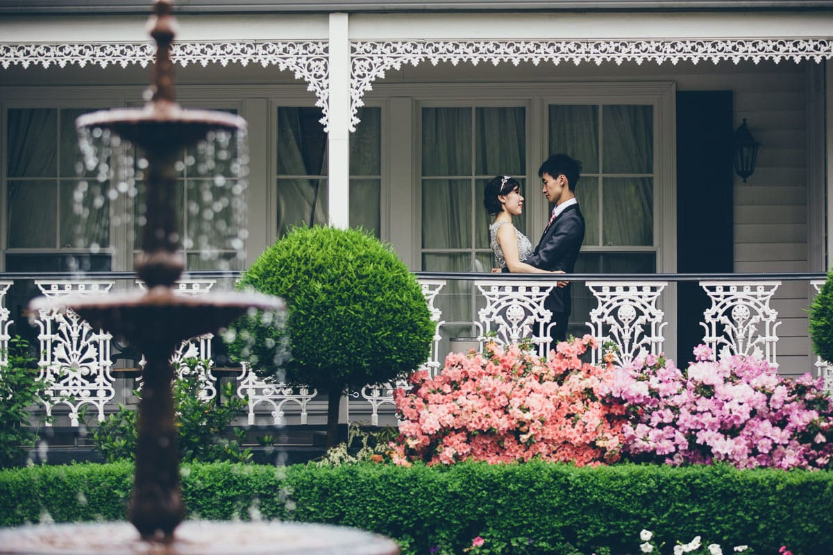 chinese couple on victorian style wedding house