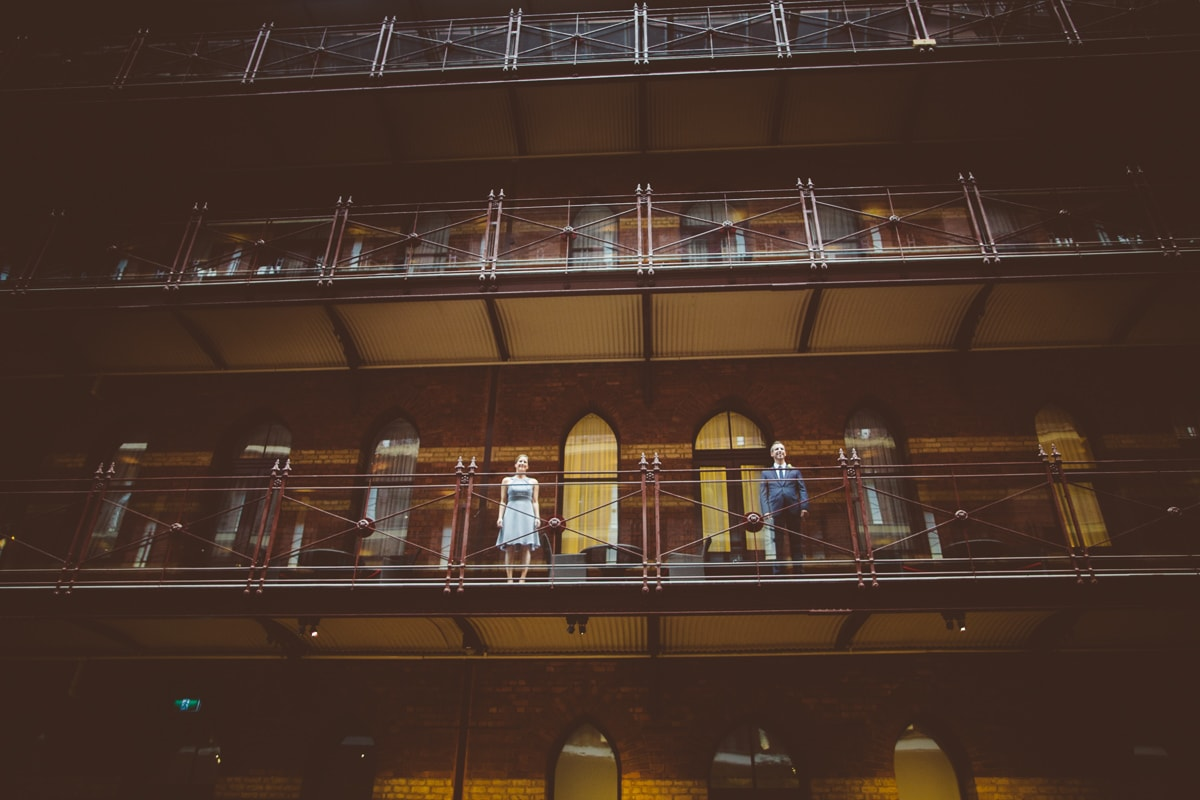balcony - creative wedding photo in melbourne hotel - best wedding photographer