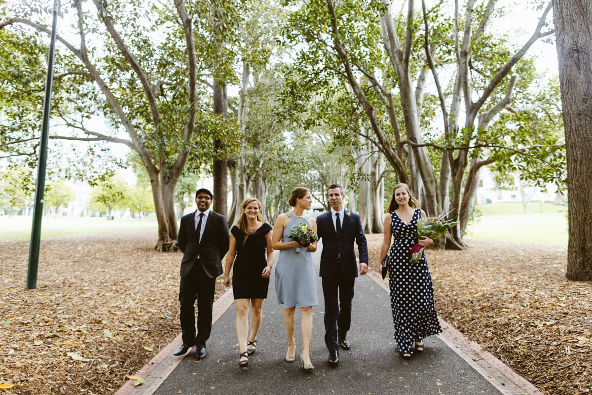 bridal team walking in treasury gardens - wedding photographer