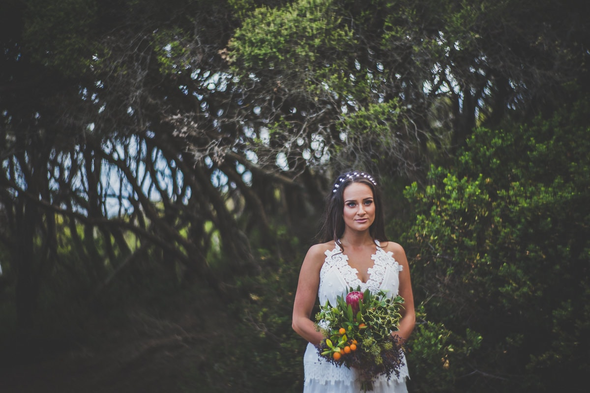 wedding portraits - beautiful bride in self portrait dress and rustic native bouquet