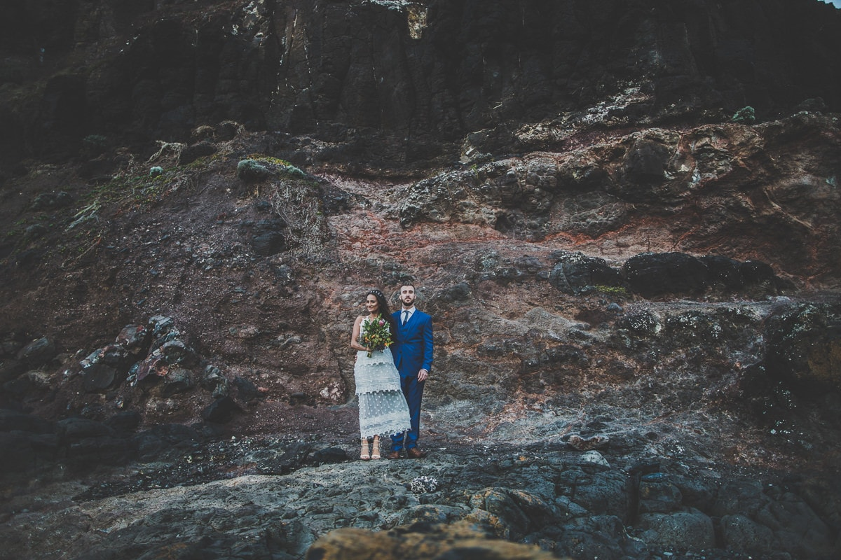 rough costal wedding photography in melbourne - rocks and beach