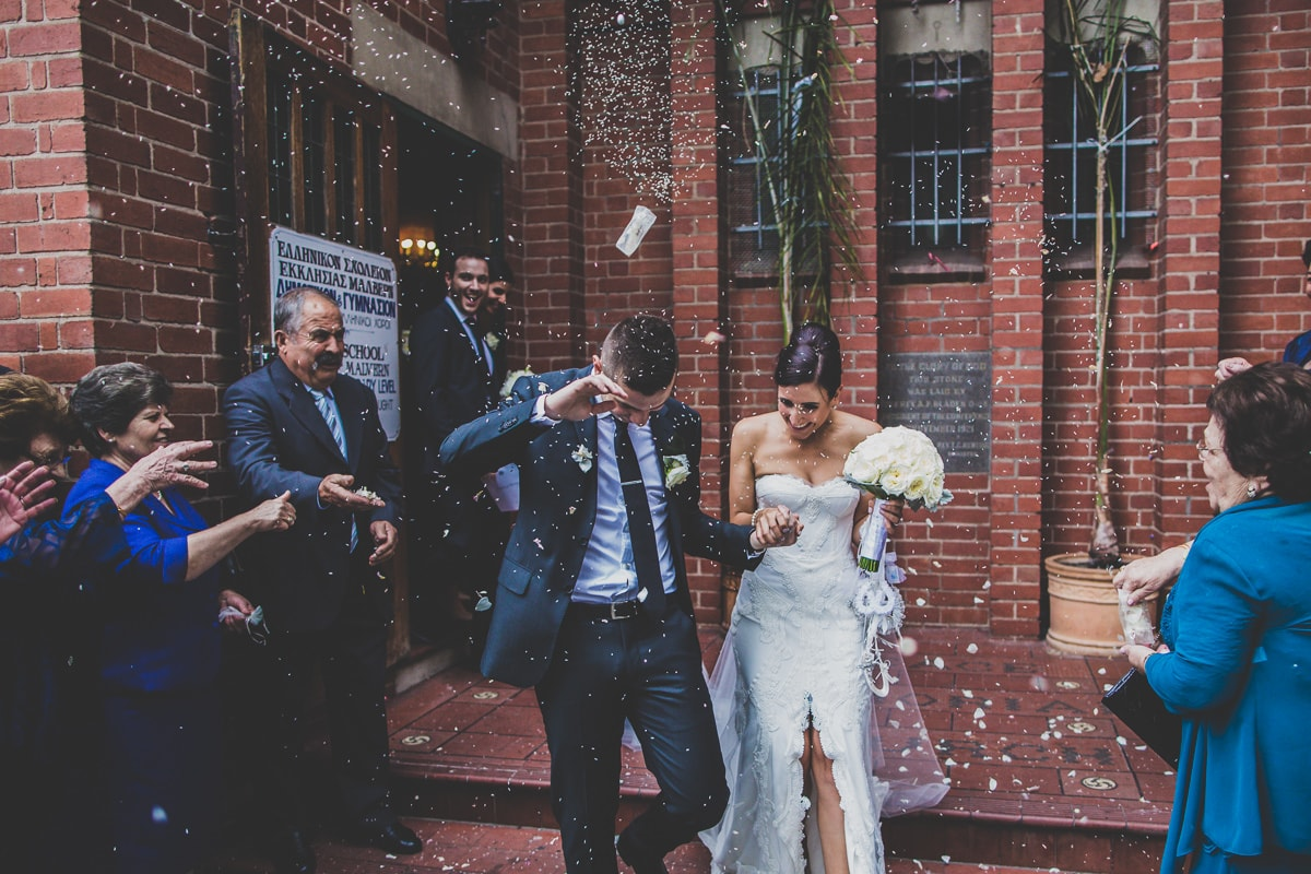 bride and groom with rise and rose petals
