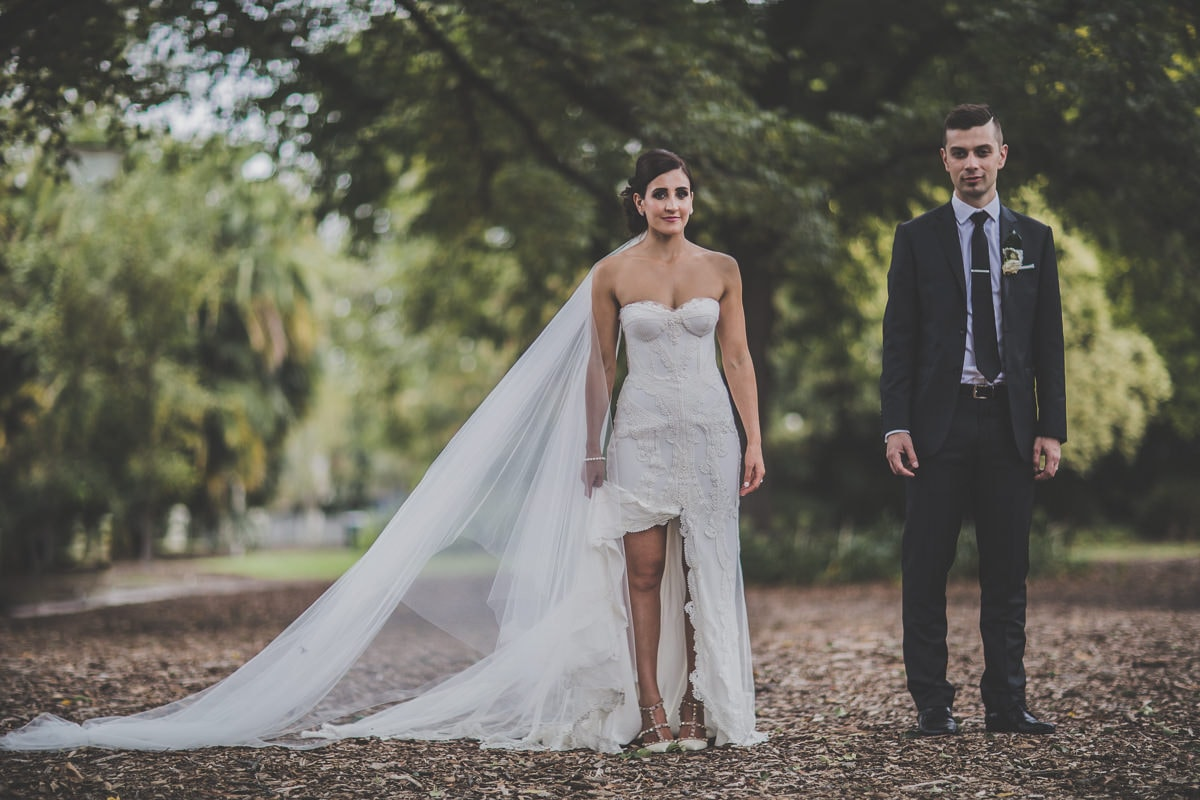 stunning bride and handsome groom in melbourne park - wedding photos in melbourne