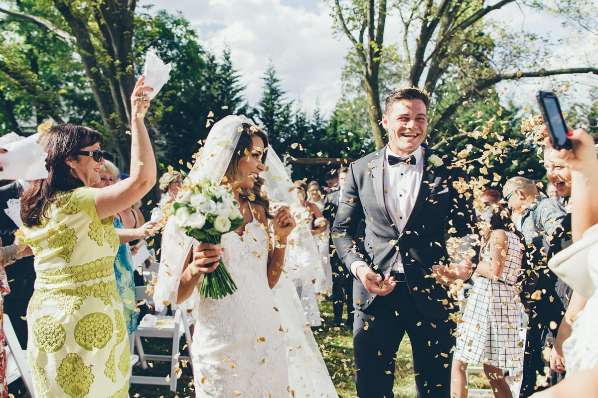 rose petals after the ceremony - capturing moments at weddings