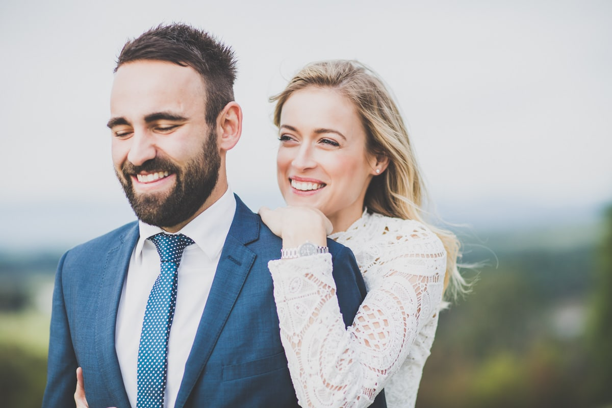 happy wedding couple captured by melbourne wedding photographer in a natural setting