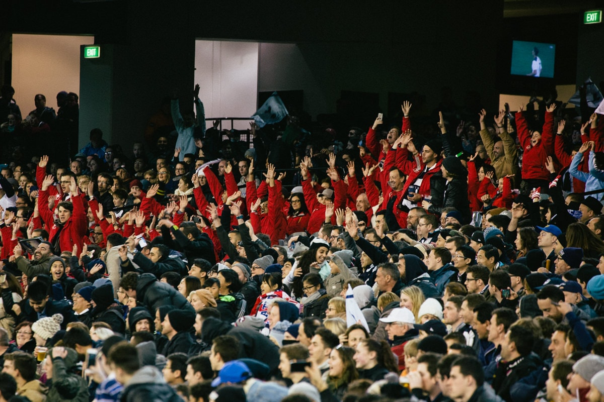 mexican wave at mcg - energy and fun at events - captured by melbourne photographer