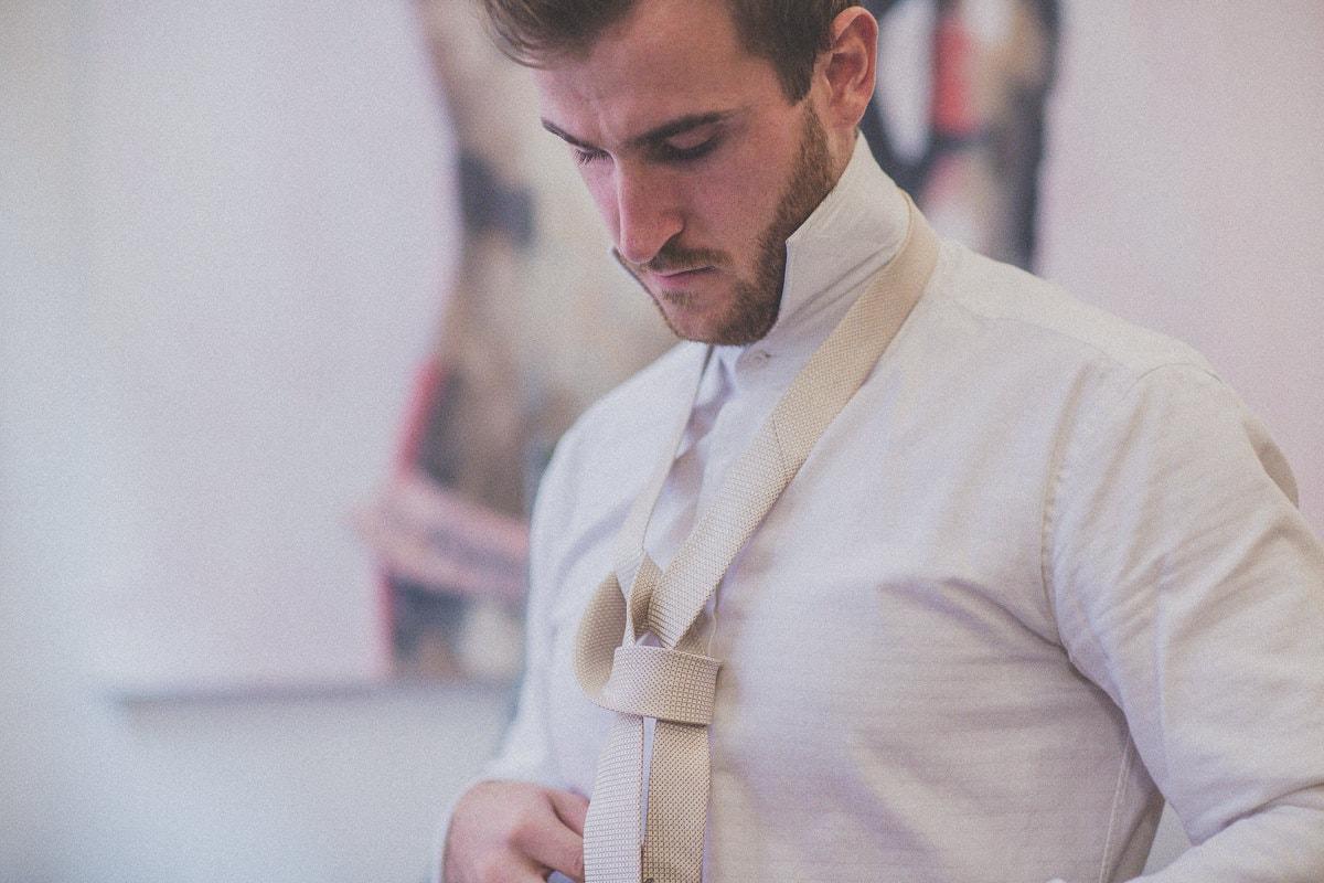 tie the tie - wedding photography