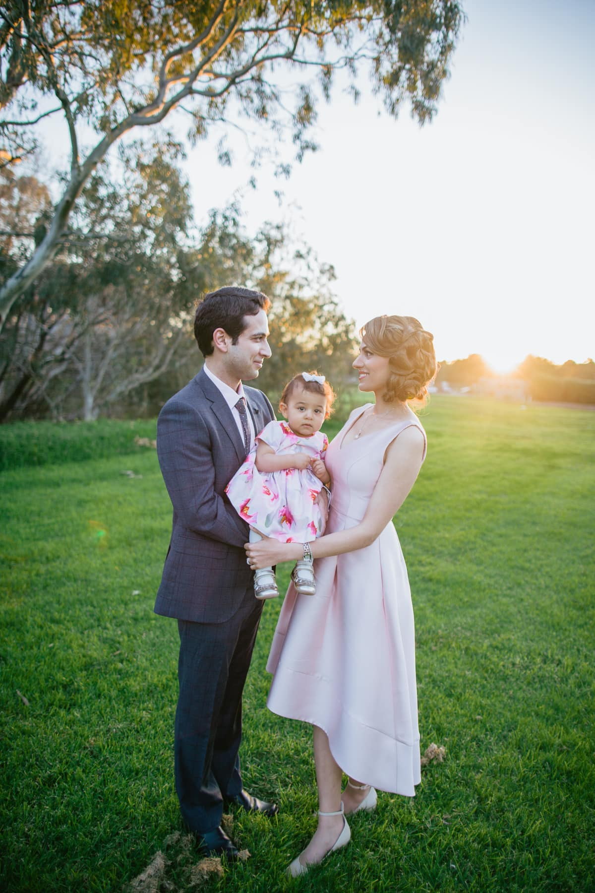 best melbourne family photographer in natural light at outdoor locations in the eastern suburbs of melbourne - family backlit by sunset