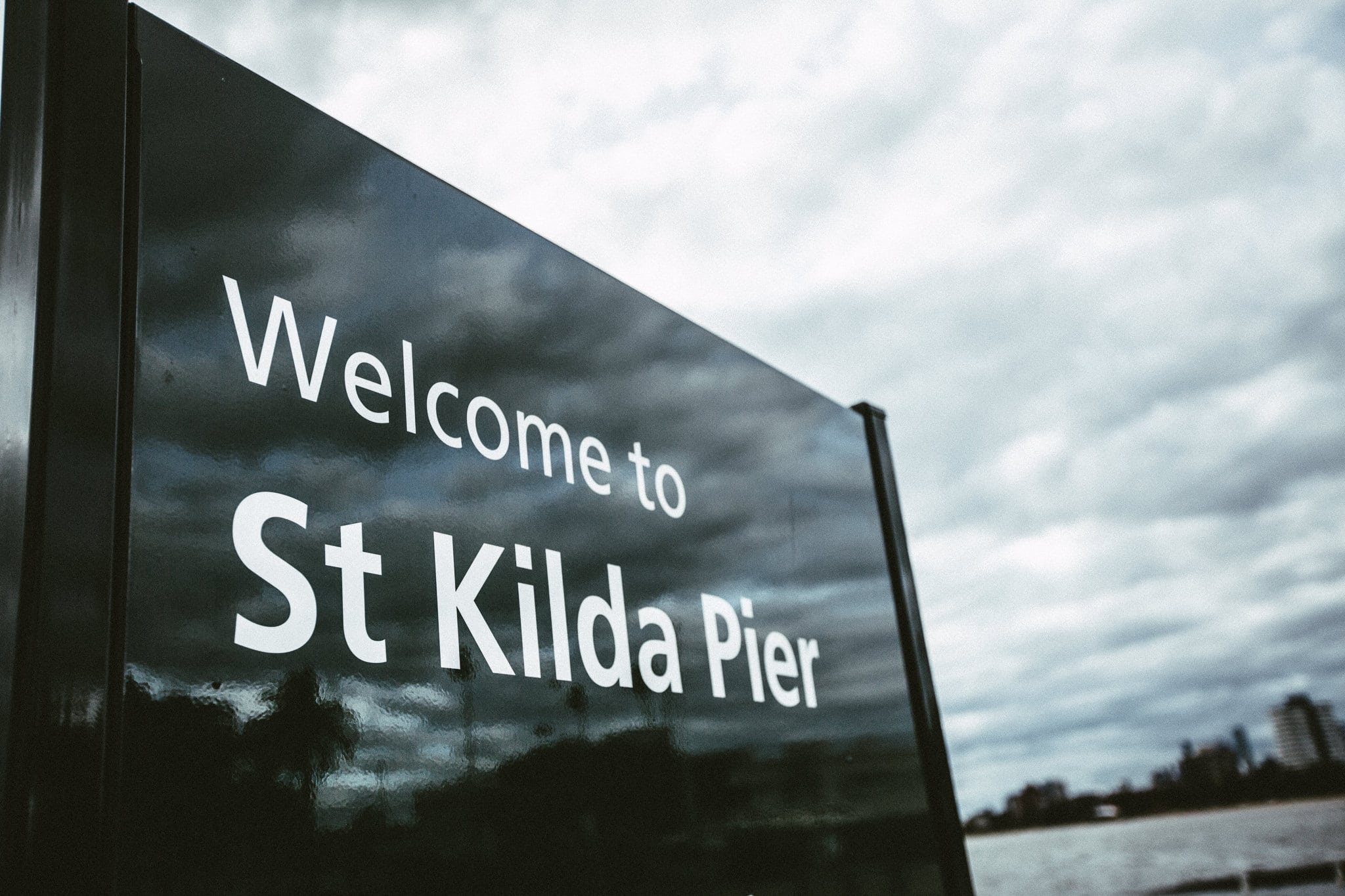 St Kilda Pier Sign at surprise engagement photography