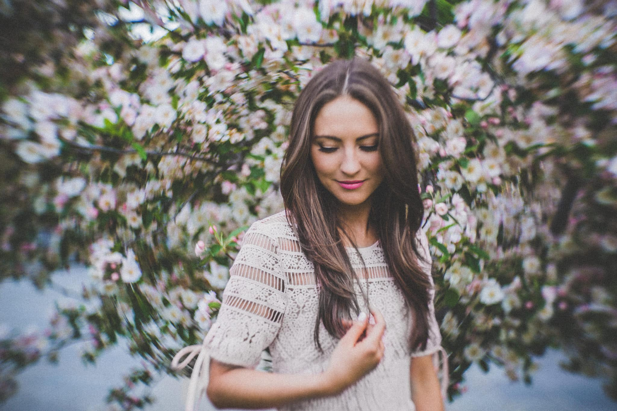 pretty girl with long hair infront of flowers in melbourne