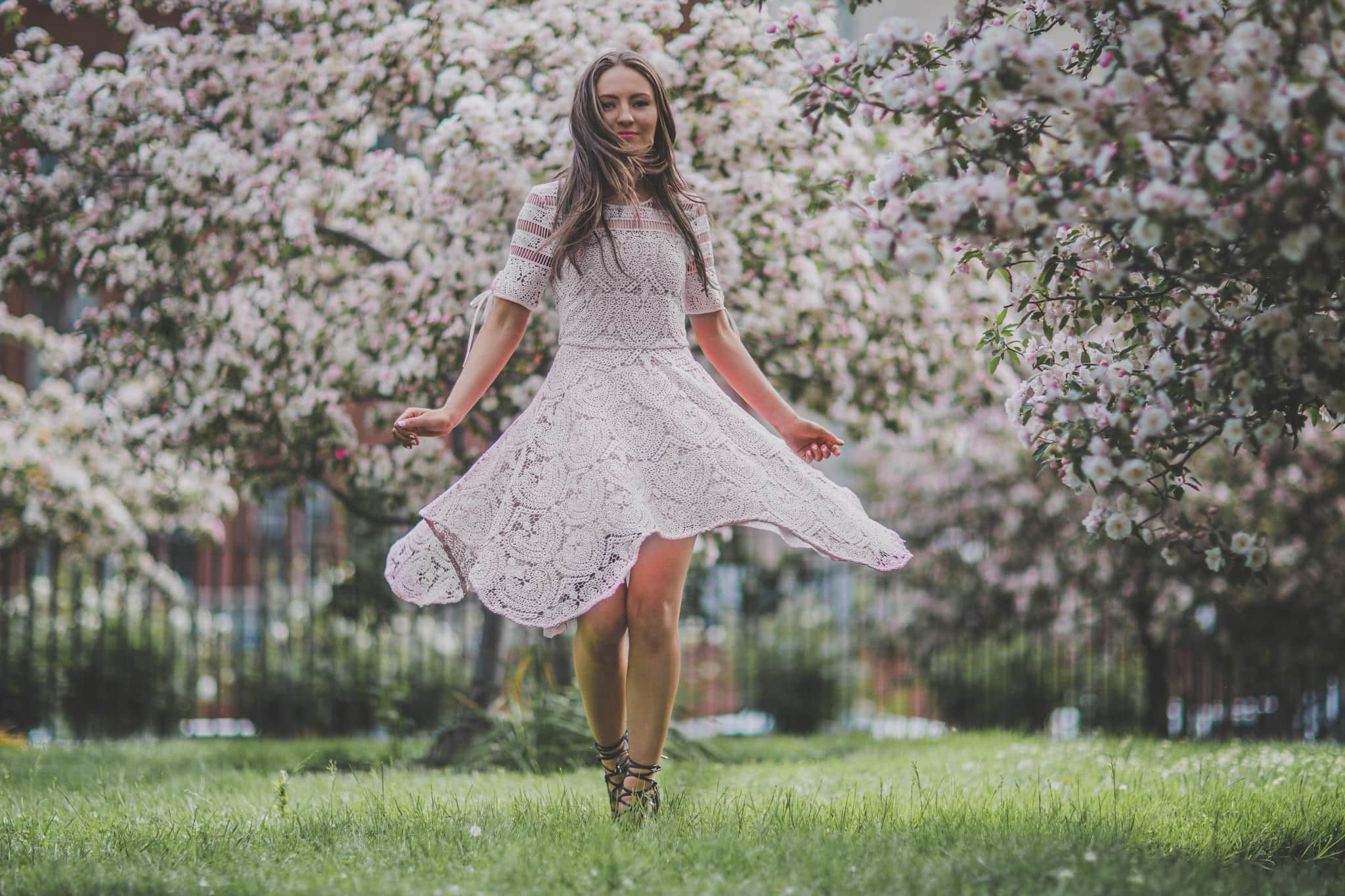 girl dancing in park with floating skirt photographed by melbourne photographer in the melbourne cbd