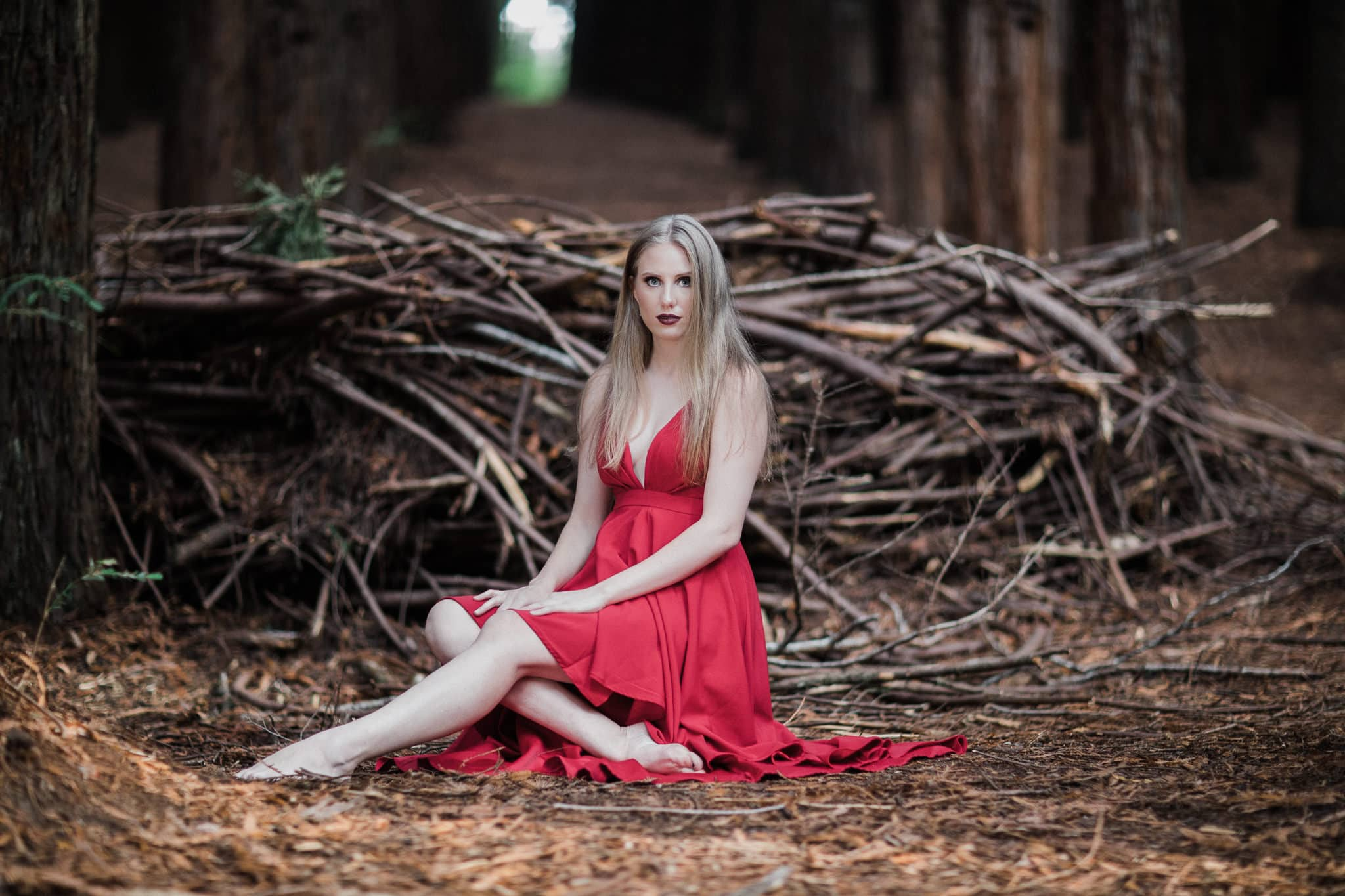 fashion photos melbourne - girl infront of birdsnest in the woods in red dress - fashion style