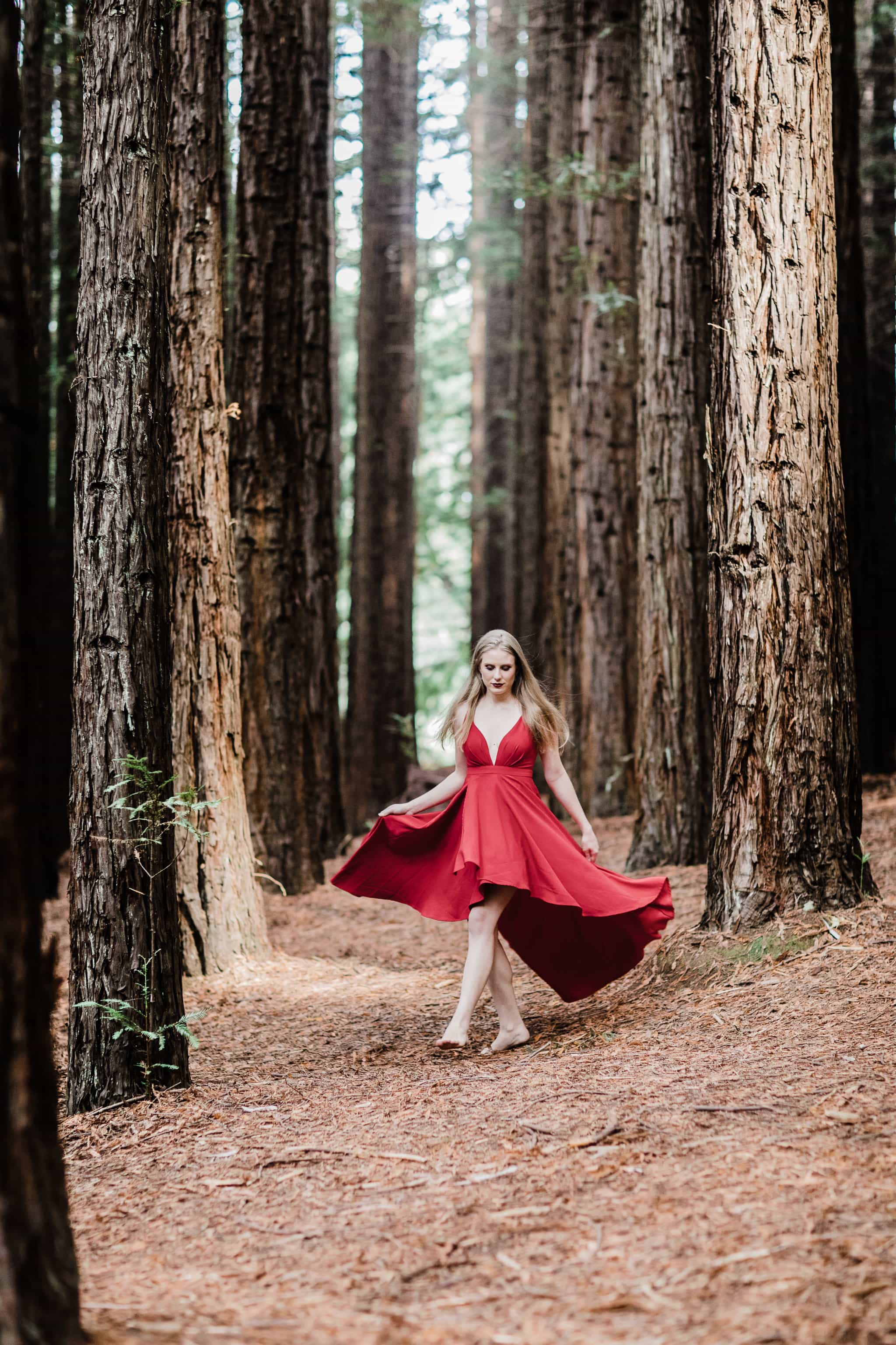 girl walking through forest in red long dress - movement of dress - barefoot