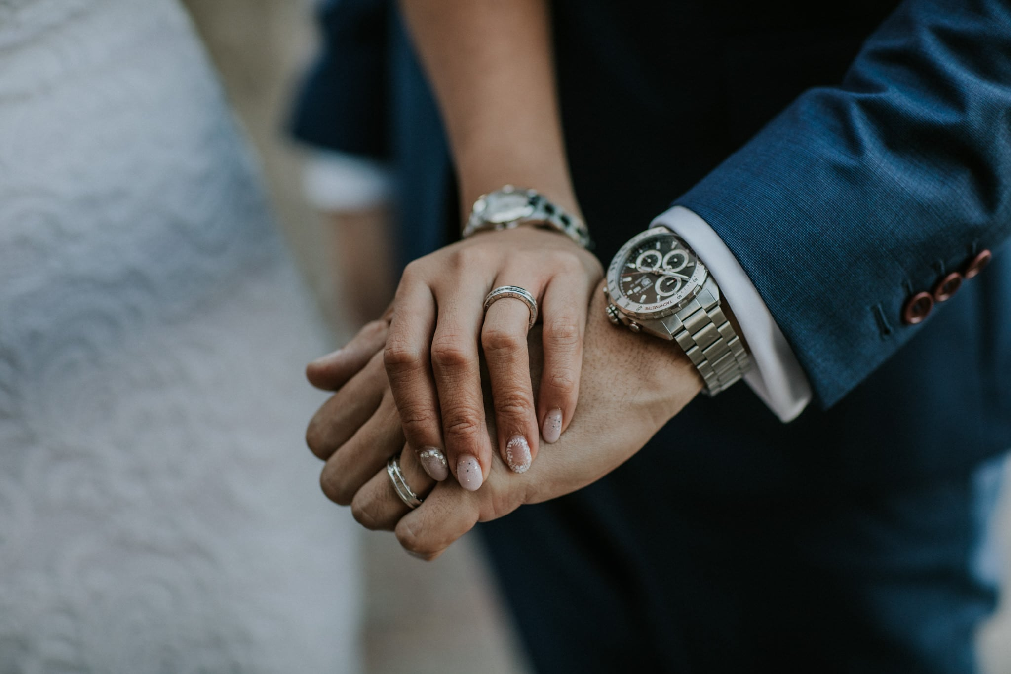 hand holding at wedding