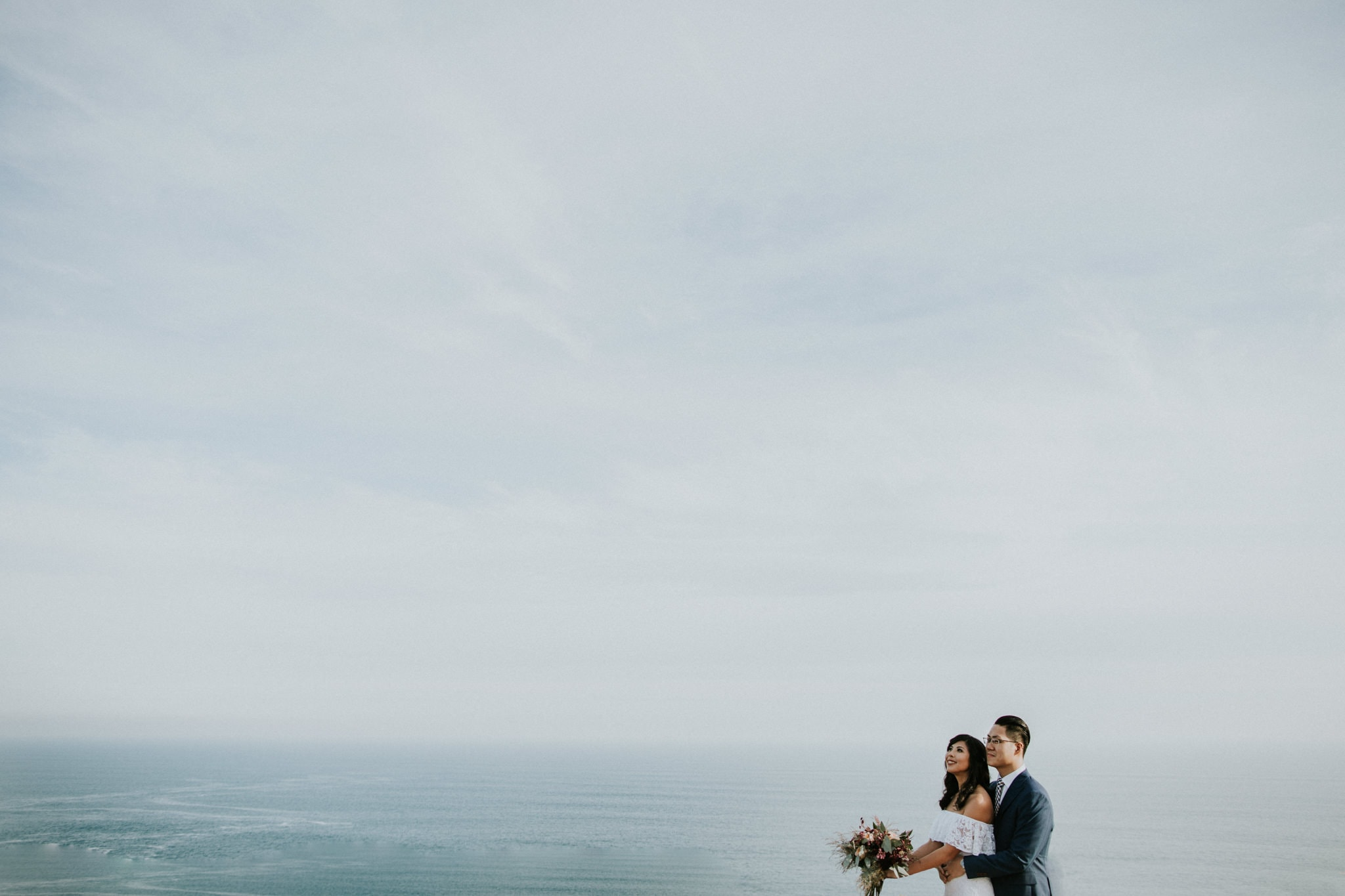 stunning wedding images with blue sky and clouds and sea - sorrento wedding photographer - luxury ocean weddings