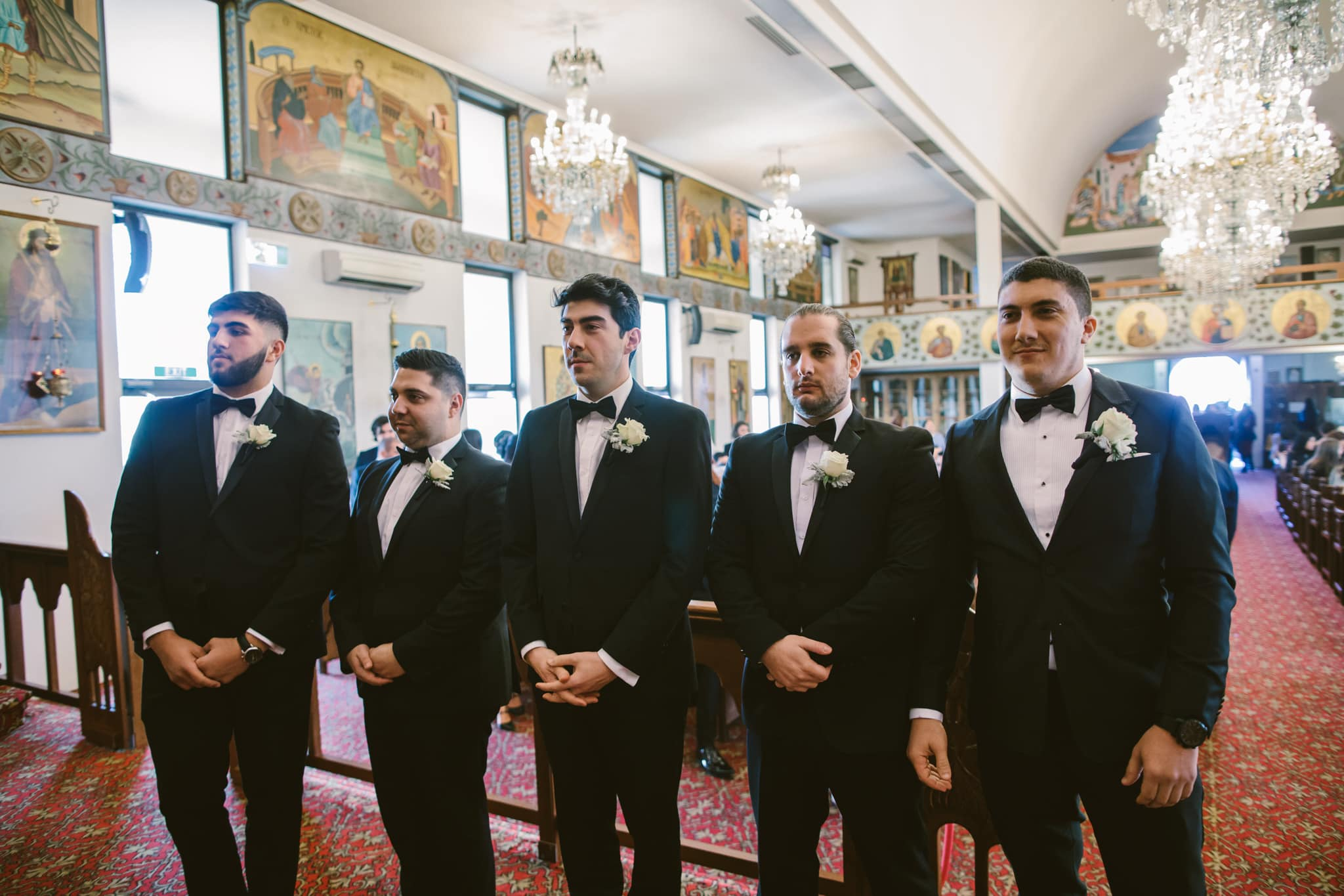 groom and groomsmen waiting for bride in church - greek weddings